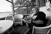 Sept. 22, 2009 - Paul looks through a photo album with photos of past summers spent with his wife at the island cottage they once owned in Vermont.