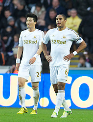 08.12.2012, Liberty Stadion, Swansea, ENG, Premier League, Swansea City vs Norwich City, 16. Runde, im Bild Swansea City's captain Ashley Williams and Ki Sung-Yeung look dejected as Norwich City score the opening goal during the English Premier League 16th round match between Swansea City AFC and Norwich City FC at the Liberty Stadium, Swansea, Great Britain on 2012/12/08. EXPA Pictures © 2012, PhotoCredit: EXPA/ Propagandaphoto/ David Rawcliffe..***** ATTENTION - OUT OF ENG, GBR, UK *****