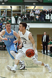 21 February 2015:  Peyton Wyatt plays catch up with Bryce Dolan near the 3 point arc during an NCAA men's division 3 CCIW basketball game between the Elmhurst Bluejays and the Illinois Wesleyan Titans in Shirk Center, Bloomington IL