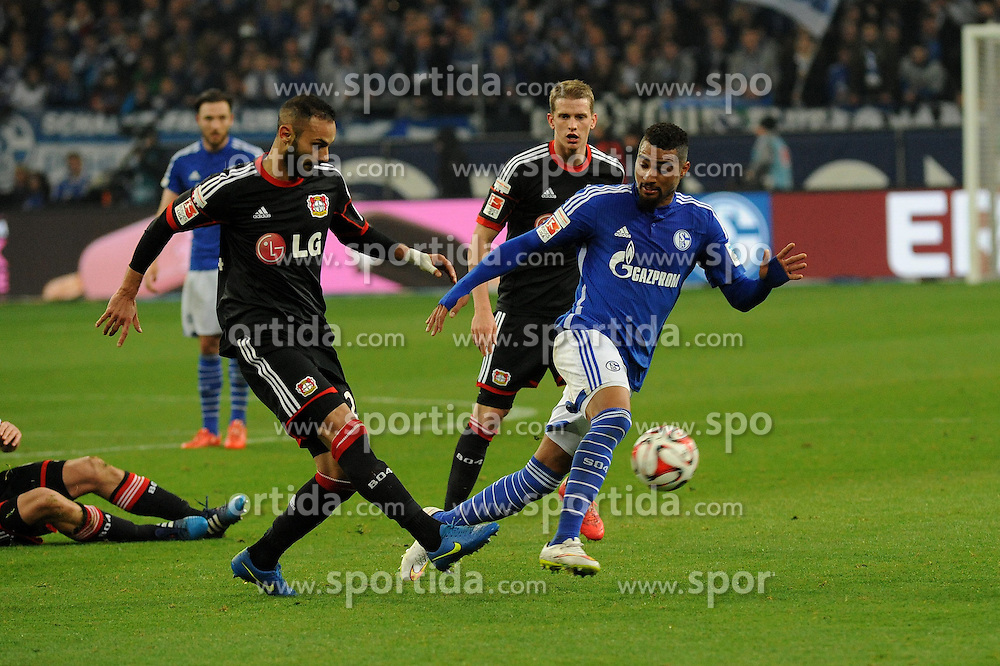 21.03.2015, Veltins Arena, Gelsenkirchen, GER, 1. FBL, Schalke 04 vs Bayer 04 Leverkusen, 26. Runde, im Bild Oemer Toprak ( links Bayer 04 Leverkusen ) klaert vor Kevin Prince Boateng ( rechts Schalke 04 ) // during the German Bundesliga 26th round match between Schalke 04 and Bayer 04 Leverkusen at the Veltins Arena in Gelsenkirchen, Germany on 2015/03/21. EXPA Pictures &copy; 2015, PhotoCredit: EXPA/ Eibner-Pressefoto/ Thienel<br /> <br /> *****ATTENTION - OUT of GER*****