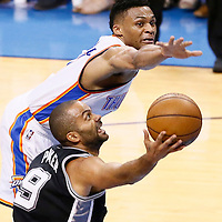 08 May 2016: San Antonio Spurs guard Tony Parker (9) goes for the layup past Oklahoma City Thunder guard Russell Westbrook (0) during the Oklahoma City Thunder 111-97 victory over the San Antonio Spurs, during Game Four of the Western Conference Semifinals of the NBA Playoffs at the Chesapeake Energy Arena, Oklahoma City, Oklahoma, USA.