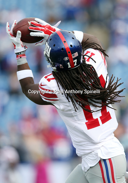New York Giants wide receiver Dwayne Harris (17) catches a pregame pass while warming up before the 2015 NFL week 4 regular season football game against the Buffalo Bills on Sunday, Oct. 4, 2015 in Orchard Park, N.Y. The Giants won the game 24-10. (©Paul Anthony Spinelli)