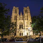 The front of the Cathedral of St. Michael and St. Gudula (in French, Co-Cathédrale collégiale des Ss-Michel et Gudule) at night. A church was founded on this site in the 11th century but the current building dates to the 13th to 15th centuries. The Roman Catholic cathedral is the venue for many state functions such as coronations, royal weddings, and state funerals. It has two patron saints, St Michael and St Gudula, both of whom are also the patron saints of Brussels.