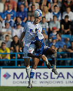 Picture by Ady Kerry/Focus Images Ltd.  .26/09/09.Gillingham's Dennis Oli challenges Norwich's Jens Berrthel Askou during their Coca-Cola League 1 game at the Priestfield Stadium, Gillingham, Kent.