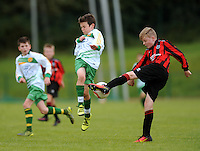 13 Aug 2016:  Rubin Doherty, left, Donegal, in action against Mark Grealish, Galway.  Boys U12 semi-final, Galway v Donegal.  2016 Community Games National Festival 2016.  Athlone Institute of Technology, Athlone, Co. Westmeath. Picture: Caroline Quinn
