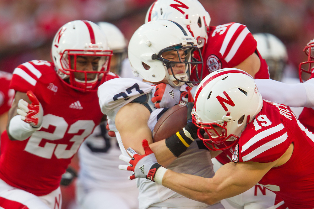 Evan Lewis (37) of the Penn State Nittany Lions finds himself surrounded by Nebraska defenders Daniel Davie (23) and Wil Richards (19).