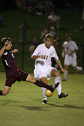 Virginia Cavaliers F Yannick Reyering (11) in action against Boston College. The Virginia Cavaliers Men's Soccer Team defeated The Boston College Eagles, 3-2 in overtime on September 15, 2006 at Klöckner Stadium in Charlottesville, VA