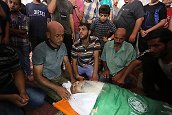 October 3, 2018 - Maghazi, Gaza Strip, Palestinian Territory - Relatives of an elderly Palestinian Ibrahim al-Arrouqi, 78, who was shot dead by Israeli forces mourn over his body during his funeral in al-Maghazi in the center of the Gaza Strip on October 3, 2018  (Credit Image: © Ashraf Amra/APA Images via ZUMA Wire)