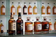 Yamazaki, November 22 2011 - Suntory whisky distillery in Yamazaki, Japan. Suntory whiskies on display in a showroom.