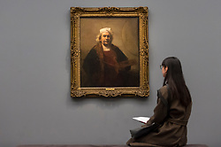 "© Licensed to London News Pictures. 11/04/2019. LONDON, UK. A visitor views ""Self-Portrait with Two Circles"", 1665, by Rembrandt van Rijn, the highlight of the exhibition. Preview of ""Visions of the Self:  Rembrandt and Now"", an exhibition at Gagosian Grosvenor Hill, in partnership with English Heritage.  The show features self-portraits by Pablo Picasso, Frances Bacon, Lucian Freud and Jean-Michel Basquiat alongside contemporary artists including George Baselitz, and Damian Hirst.  Photo credit: Stephen Chung/LNP"