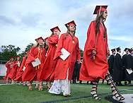Daniella Lucia Pileggi (R) leads some of her graduating classmates as they enter the stadium for Hatboro Horsham High School Commencement ceremonies Monday June 8, 2015 in Horsham, Pennsylvania.  (Photo by William Thomas Cain/Cain Images)