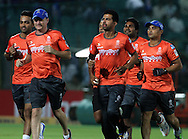 Rajasthan Royals players warm up before the start of the match 1 of the Karbonn Smart Champions League T20 (CLT20) 2013  between The Rajasthan Royals and the Mumbai Indians held at the Sawai Mansingh Stadium in Jaipur on the 21st September 2013<br /> <br /> Photo by Vipin Pawar-CLT20-SPORTZPICS <br /> <br /> Use of this image is subject to the terms and conditions as outlined by the CLT20. These terms can be found by following this link:<br /> <br /> http://sportzpics.photoshelter.com/image/I0000NmDchxxGVv4