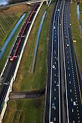 Nederland, Gelderland, Gemeente Valburg, 10-01-2011;.Infrabundel A15 en Betuweroute bij Herveld. Goederenvervoer over het spoor. Freight transport by rail. Infra cluster for transport. .luchtfoto (toeslag), aerial photo (additional fee required).foto/photo Siebe Swart