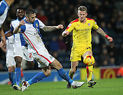 Shane Duffy (Blackburn Rovers) goes to tackle Luke Hyam (Rotherham United) during the Sky Bet Championship match between Blackburn Rovers and Rotherham United at Ewood Park, Blackburn, England on 11 December 2015. Photo by Mark P Doherty.
