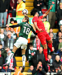 Oscar Threlkeld of Plymouth Argyle challenges Emre Can of Liverpool - Mandatory by-line: Matt McNulty/JMP - 08/01/2017 - FOOTBALL - Anfield - Liverpool,  - Liverpool v Plymouth Argyle - Emirates FA Cup third round