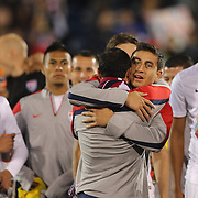 Landon Donovan, USA, is congratulated by team mates after his farewell match during the USA Vs Ecuador International match at Rentschler Field, Hartford, Connecticut. USA. 10th October 2014. Photo Tim Clayton