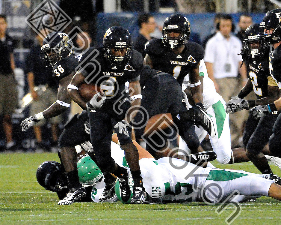 2011 September 01 - Florida International wide receiver T.Y. Hilton (4) evading tackles. Florida International University Golden Panthers defeated the University of North Texas Mean Green (41-16) in the Alfonso Field at FIU Stadium, Miami, Florida. (Photo by: www.photobokeh.com / Alex J. Hernandez)