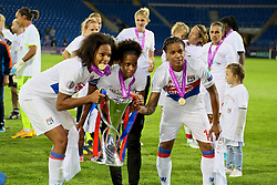 CARDIFF, WALES - Thursday, June 1, 2017: Olympique Lyonnais' Wendie Renard [L] and Élodie Thomis [R] celebrate with the trophy after winning the UEFA Champions League following a penalty-shoot out victory during the UEFA Women's Champions League Final between Olympique Lyonnais and Paris Saint-Germain FC at the Cardiff City Stadium. (Pic by David Rawcliffe/Propaganda)
