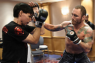 BIRMINGHAM, ENGLAND, NOVEMBER 2, 2011: Chris Leben (right) works on his striking at the media open work-out sessions inside the Hilton Hotel on November 2, 2011.