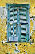 Athens, Greece: closed shutters, yellow wall