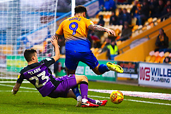 Craig Davies of Mansfield Town trips over the legs of Mitchell Clark of Port Vale - Mandatory by-line: Ryan Crockett/JMP - 17/11/2018 - FOOTBALL - One Call Stadium - Mansfield, England - Mansfield Town v Port Vale - Sky Bet League Two