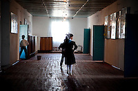 Students walk down a hallway in a school ia Aralsk, Kazakhstan. There is a high child mortality rate of 75 in every 1,000 newborns and maternity death of 12 in every 1,000 women.