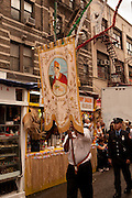New York, NY -24 September 2011. The feast of San Gennaro in New York's Little Italy. The banner of the Figli de San Gennaro (Children of San Gennaro) leading the parade.