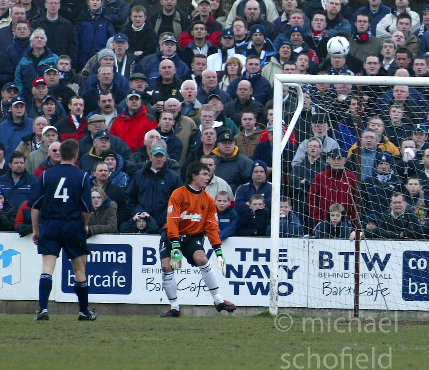 Queen's Alex Burke scores over Darren Hill for the 1st goal.<br />