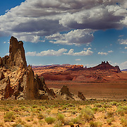 Diatremes or volcanic plugs of Church Rock, Agathla Peak (far right) and others east of Kayenta, AZ, on the outskirts of Monument Valley