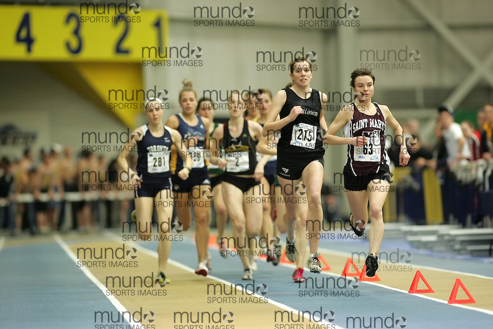 (Windsor, Ontario---12 March 2010) Ashley Ryer of Saint Mary's University   Julia Malleck of University of Ottawa Gee-Gees   competes in the 1000m final at the 2010 Canadian Interuniversity Sport Track and Field Championships at the St. Denis Center. Photograph copyright Sean Burges/Mundo Sport Images. www.mundosportimages.com