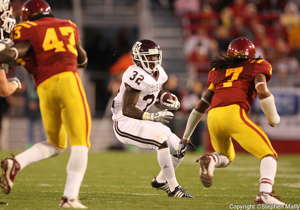 25 OCTOBER 2008: Texas A&M running back Cyrus Gray (32) tries to get around Iowa State defensive back Kennard Banks (7) in the first half of an NCAA college football game between Iowa State and Texas A&M, at Jack Trice Stadium in Ames, Iowa on Saturday Oct. 25, 2008. Texas A&M beat Iowa State 49-35.
