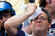 Roma 18 Giugno 2013<br /> I  Movimenti per la casa  assediano il Tribunale Civile per chiedere  il blocco degli sfratti. Le forze dell'ordine  bloccano l'ingresso al tribunale.Un manifestante  con il ghiaccio sulla testa dopo una manganellata di un poliziotto<br /> Movements for the house, besieging the Civil Court to ask for the block evictions. The police blocked the entrance to the court.