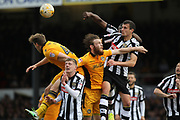Haydn Hollis clears under pressure from Mark O'Brien  during the EFL Sky Bet League 2 match between Newport County and Notts County at Rodney Parade, Newport, Wales on 6 May 2017. Photo by Daniel Youngs.