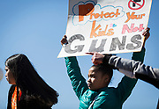 High school students hold signs outside the  State Capitol in support of stronger gun regulation and legislation during a walkout in Madison, Wisconsin, Wednesday, March 14, 2018.
