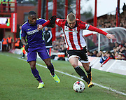 Brentford defender, Jake Bidwell (3) battling for ball with Charlton Athletic midfielder, Callum Harriott (11) during the Sky Bet Championship match between Brentford and Charlton Athletic at Griffin Park, London, England on 5 March 2016. Photo by Matthew Redman.