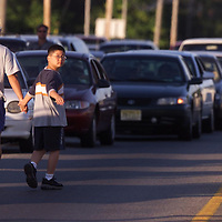 (PPAGe1) Hazlet 9/3/2001  A father and son walk down hwy 36 near pool avenue  after fire cause major traffic tieups.   Michael J. Treola STaff Photographer........MJT