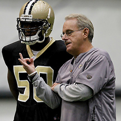 July 27, 2012; Metairie, LA, USA; New Orleans Saints assistant head coach and linebackers coach talks with linebacker Curtis Lofton (50) during training camp at the team's indoor practice facility. Mandatory Credit: Derick E. Hingle-US PRESSWIRE