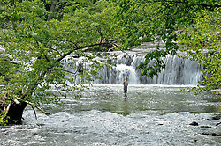 Fisherman at Sandstone Falls, New River Gorge National River in West Virginia.