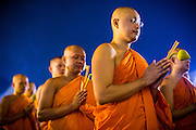 "25 FEBRUARY 2013 - BANGKOK, THAILAND:   Buddhist monks pray before leading a candle light procession around Wat Benchamabophit Dusitvanaram (popularly known as either Wat Bencha or the Marble Temple) on Makha Bucha Day. Thais visit temples throughout the Kingdom on Makha Bucha Day to make merit and participate in candle light processions around the temples. Makha Bucha is a Buddhist holiday celebrated in Myanmar (Burma), Thailand, Cambodia and Laos on the full moon day of the third lunar month (February 25 in 2013). The third lunar month is known in Thai is Makha. Bucha is a Thai word meaning ""to venerate"" or ""to honor"". Makha Bucha Day is for the veneration of Buddha and his teachings on the full moon day of the third lunar month. Makha Bucha Day marks the day that 1,250 Arahata spontaneously came to see the Buddha. The Buddha in turn laid down the principles his teachings. In Thailand, this teaching has been dubbed the 'Heart of Buddhism'.    PHOTO BY JACK KURTZ"