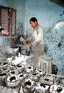Child labour in Luxor, where young children worked in very dark and unventilated buildings with glue and a sort of melted black plastic, which they had to melt and than pour in special made blocks of stone. The smell was killing and the air was very hot. They worked with grinders and primitive tools to correct the shapes of cats and other sorts of statues.<br />