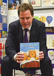 "© Licensed to London News Pictures. 30/05/2013. Gravesend, UK Nick Clegg reads the Children's story ""Peace at Last"" by Jill Murphy to the class of children. British Deputy Prime Minister and Liberal Democrat MP, Nick Clegg, visits Bright Beginnings Nursery to promote the Governments free childcare for two year olds scheme today 30th May 2013. Photo credit : Stephen Simpson/LNP"
