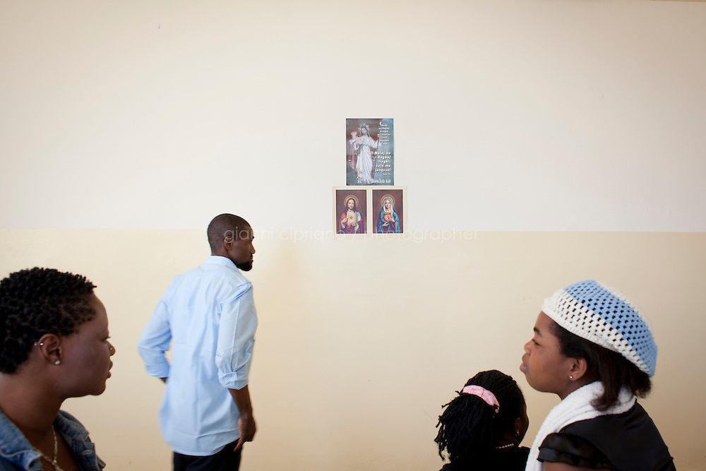 HAL FAR, MALTA - JUNE 20: Sub-saharan immigrants that arrived from Libya are here in a room with catholic icons at the  Lyster Barracks Closed Center, a detention center for immigrants in Hal Far (which translates as Rats' town), Malta, on June 20, 2011. All immigrants who enter in Malta illegally are detained. Upon arrival to Malta, irregular migrants and asylum seekers are sent to one of three dedicated immigration detention facilities: the Lyster Barracks Closed Centre, the Safi Closed Centre, and the Ta'kandja Closed Centre. Once apprehended by the authorities, immigrants remain in detention even after they apply for refugee status. detention lasts as long as it takes for asylum claims to be determined. This usually takes months; asylum seekers often wait five to 10 months for their first interview with the Refugee Commissioner. Asylum seekers may be detained for up to 12 months: at this point, if their claim is still pending, they are released and transferred to an Open Center.