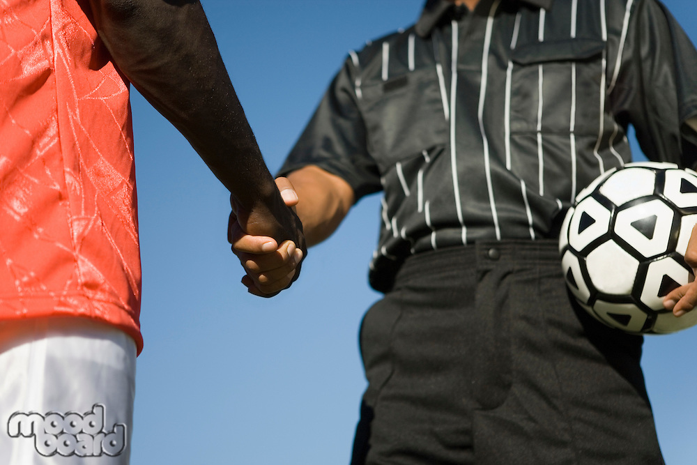 Referee and Player Shaking Hands