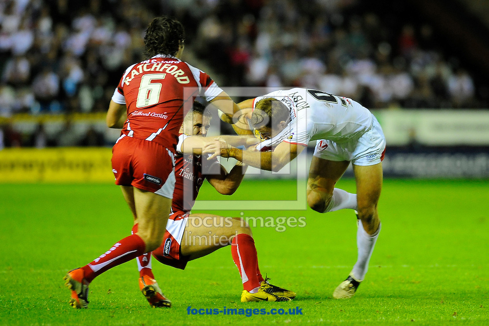 Picture by Ste Jones/Focus Images Ltd.  07706 592282.13/8/11..James Roby of StHelens is collared during the Engage Super League game at the Stobart Stadium Halton, Widnes , Cheshire