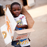 A boy laying with a box in Avenor, a slum in Ghana's capital, Accra.