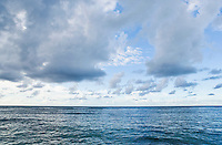 The Pacific Ocean with clouds in the late afternoon on the north shore of Kauai, Hawaii.