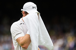LONDON, ENGLAND - Saturday, July 2, 2016:  Andy Murray (GBR) wiping his face with a towel during the Gentlemen's Single 3rd Round match on day six of the Wimbledon Lawn Tennis Championships at the All England Lawn Tennis and Croquet Club. (Pic by Kirsten Holst/Propaganda)