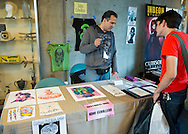 Garden City, New York. 15th June 2013. JOHN CEBOLLERO, the Garbage Paul Kids Artist, is speaking with a fan at the Artists Alley, at the Eternal Con Pop Culture Expo, which was hosted by the Cradle of Aviation Museum of Long Island.