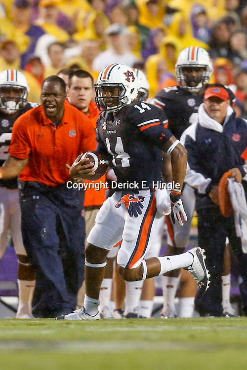 Sep 21, 2013; Baton Rouge, LA, USA; Auburn Tigers quarterback Nick Marshall (14) against the LSU Tigers during the first half of a game at Tiger Stadium. Mandatory Credit: Derick E. Hingle-USA TODAY Sports