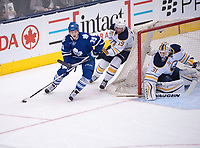 March 19, 2016:  Toronto Maple Leafs Center William Nylander (39) [10756] skates around the goal as Buffalo Sabres Left Wing Cal O'Reilly (19) [5329] defends and Goalie Chad Johnson (31) [5851] tends goalin the first period of game between the Buffalo Sabres and the Toronto Maple Leafs at the Air Canada Centre in Toronto, ON, Canada. (Photo by Peter Llewellyn/ Icon Sportswire)